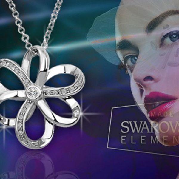 Luxusní pozlacený šperk ve tvaru květiny s krystaly Swarovski a řetízkem.