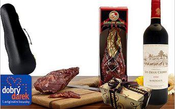 Gurmánská sada. Španělská kýta Jamón, láhev Bordeaux a belgické pralinky.