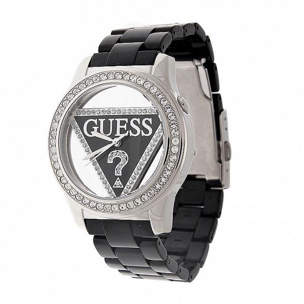 Dámské černo-stříbrné náramkové hodinky Guess s transparentním ciferníkem