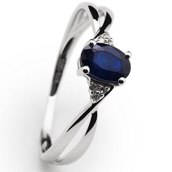 Prsten z bílého zlata s modrým safírem