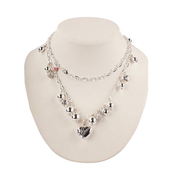 Dámský náhrdelník Guess stříbrný s přívěšky