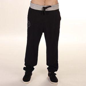 Pánské černé teplákové kalhoty s šedým pasem Reebok