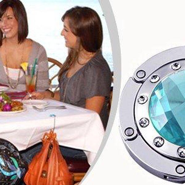Již žádné kabelky odložené na zemi.Tento elegantní šperk je složený praktický věšáček na kabelku, který je možné umístit na stůl v kavárně, restauraci, práci i jinde.Háček na kabelkuje výborný dárek pro každou ženu.