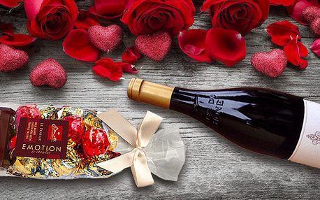 Láhev francouzského vína a belgické pralinky