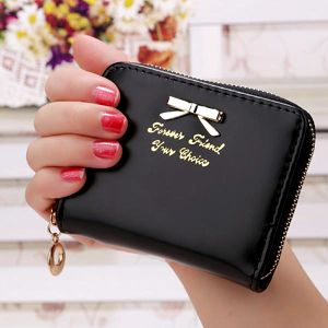 Dámská peněženka s ozdobnou mašlí - skladovka - poštovné zdarma