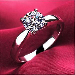 Dámský prsten s drobným kamínkem - stříbrná barva