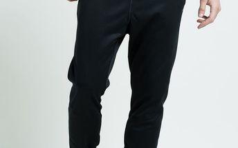 Reebok - Kalhoty Wor Warm Poly Fleec