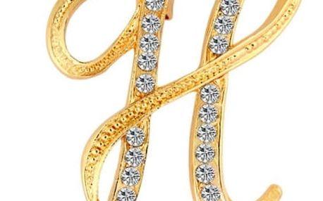 Brož ve tvaru písmen ve zlaté barvě