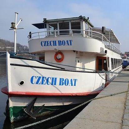 Plavba vánočně vyzdobenou lodí po Vltavě, vánoční cukroví, svařák nebo horká čokoláda a koledy.