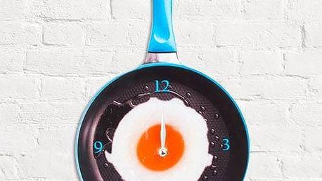 Volské oko na pánvi nástěnné hodiny