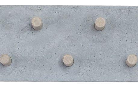 Betonový nástěnný věšák od Jakuba Velínského