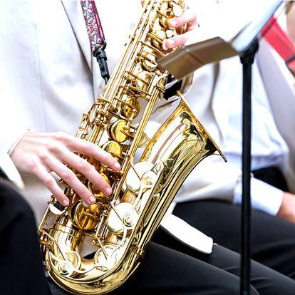 Vstupenka na koncert Českého saxofonového kvartetav barokním kostele sv. Máří Magdaleny.