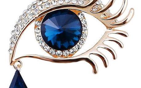 Brož v podobě oka se slzičkou vykládaná kamínky.