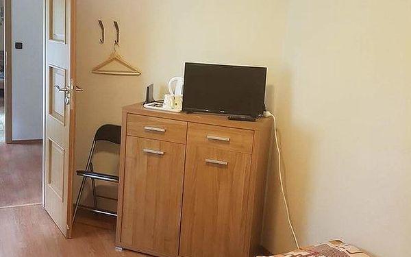 Dvoulůžkový pokoj s oddělenými postelemi a sdílenou koupelnou5